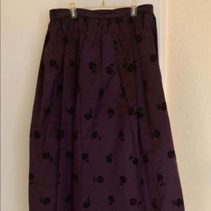 Formal plum colored skirt with velvet roses